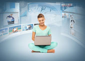 Woman with laptop pc and virtual screens — Stock Photo