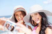 Girls taking self portrait on the beach — Stock Photo