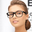 Woman in eyeglasses with eye chart — Stock Photo #30551111