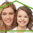 Mother and daughter with eco house — Stock Photo