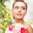 Woman with diamond earrings and flowers — Stock Photo