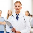 Male doctor with stethoscope and clipboard — Stock Photo