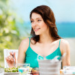 Girl eating in cafe on the beach — Stockfoto