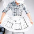 Male architect in helmet with blueprint — Stock Photo