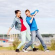 Couple of teenagers dancing outside — Stock Photo