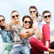 Teenagers showing thumbs up — Stock Photo