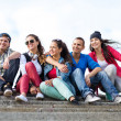 Teenagers with skates outside — Stock Photo #30552977