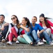Stock Photo: Teenagers with skates outside