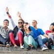 Group of teenagers waving hands — Stock Photo