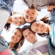 Group of teenagers looking down — Stock Photo #30553043