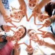 Group of teenagers showing finger five — Stockfoto