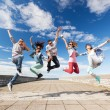 Group of teenagers jumping — Stock Photo #30553101