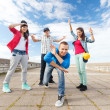 Group of teenagers dancing — Stock Photo