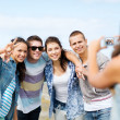 Teenagers taking photo outside — Stock Photo #30553167