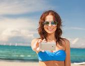 Woman in bikini and sunglasses — Stock Photo
