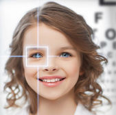 Cute girl with eye chart — Stock Photo