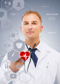 Male doctor with stethoscope and virtual screen — Stock Photo