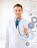 Doctor with stethoscope and virtual screen — Stockfoto
