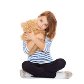 Cute little girl hugging teddy bear — Stock Photo