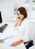 Businesswoman with smartphone in office — Stock Photo