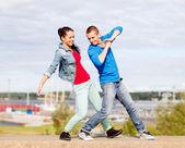 Couple of teenagers dancing outside — Stock Photo