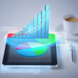 Tablet pc with virtual graph or chart — Stock Photo