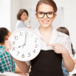 Student showing clock — Stockfoto