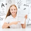 Stock Photo: Girl with test and A grade at school