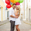 Foto Stock: Couple with colorful balloons