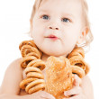 Cute todler eating long bread — Stock Photo #30595933