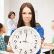 Student showing clock — Foto Stock