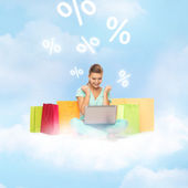 Woman doing internet shopping — Stock Photo