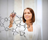 Businesswoman drawing network contacts — Stock Photo