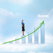 Businesswoman with big 3d chart in the sky — Stock Photo