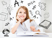 Little student girl studying at school — Stock Photo