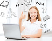 Girl with laptop pc at school — Stock Photo