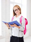 Girl reading book at school — Stock Photo