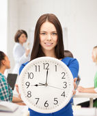 Student showing clock — Stock Photo
