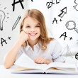 Little student girl studying at school — Stock Photo #30756555
