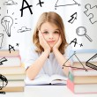 Foto Stock: Student girl studying at school