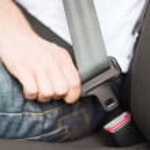 Man fastening seat belt in car — Stock Photo