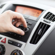 Man using car audio stereo system — Stockfoto