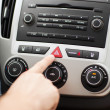 Foto Stock: Man pressing car hazard warning button