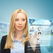 Woman with virtual screen and news — Stock Photo