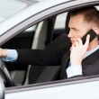 Man using phone while driving the car — Stock Photo #30758757