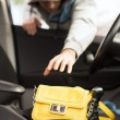 Thief stealing bag from the car — Foto Stock