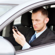 Man using phone while driving the car — Stock Photo #30759477
