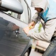 Thief breaking the car lock — Stock Photo