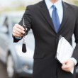 Man with car key outside — Stock Photo #30759991