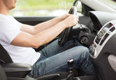 Man driving the car with manual gearbox — Stock Photo